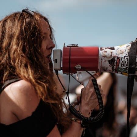 A woman speaks into a megaphone