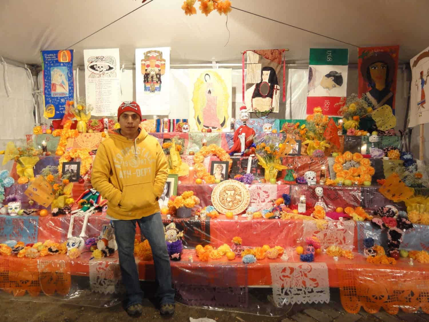 A man in front of a colorful display