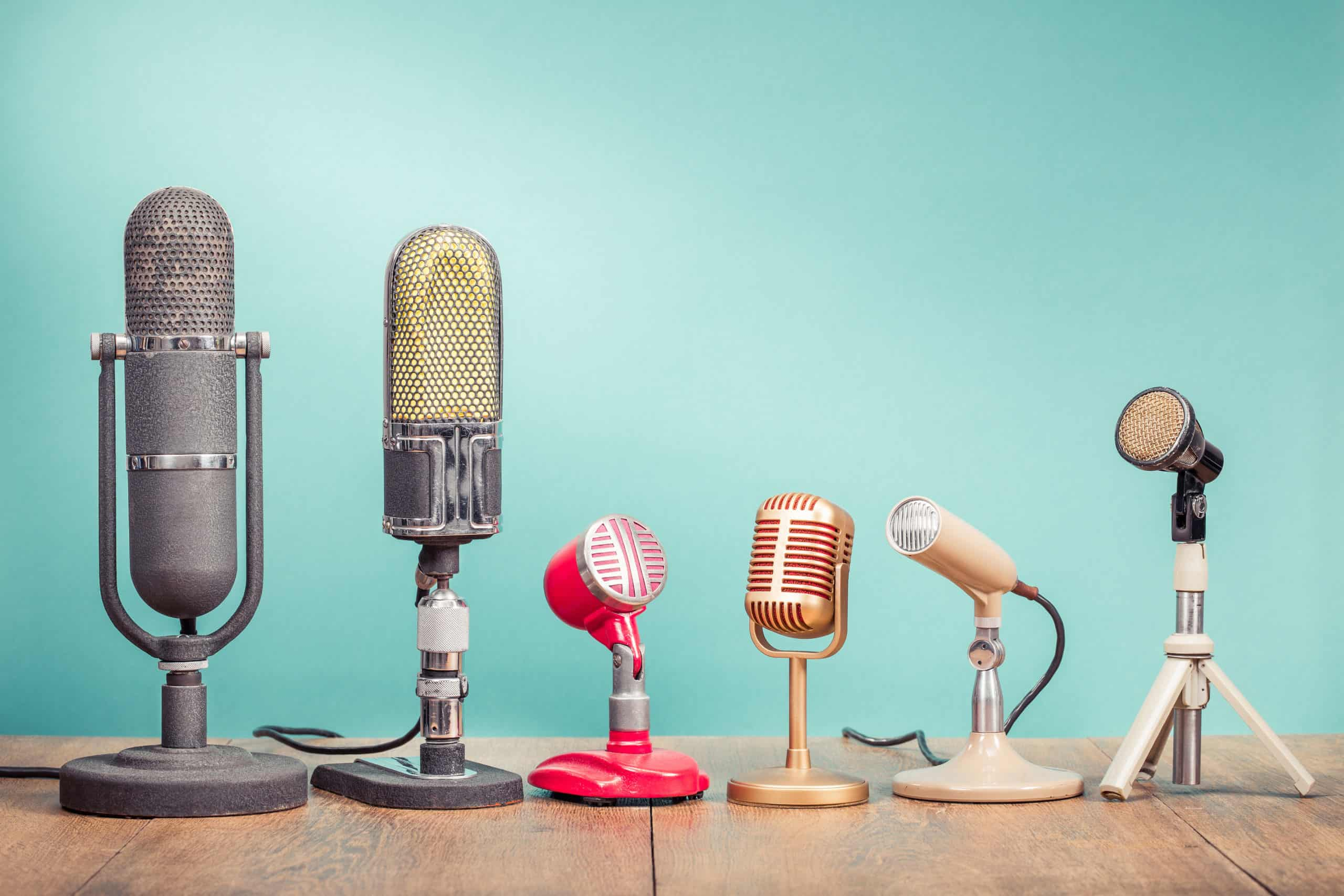A row of microphones on a blue background