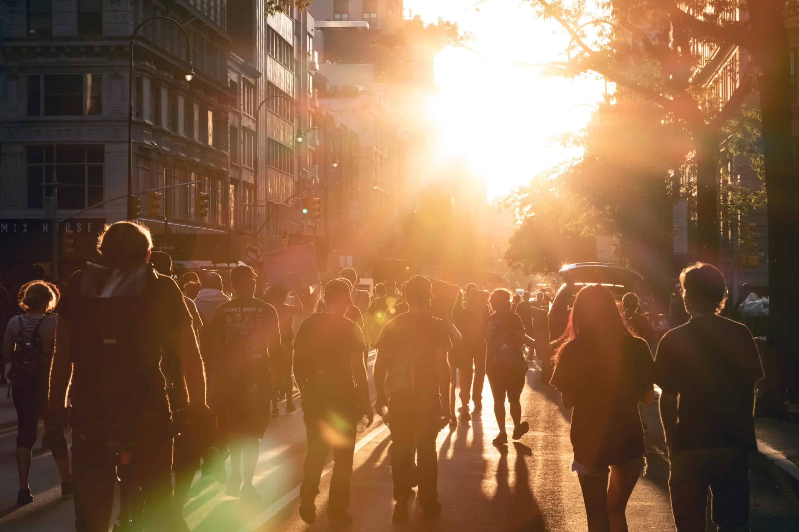 NEW YORK CITY, USA - JUNE 12, 2020: Crowd of people walk into the light of sunset at a peaceful protest march on 14th Street in Manhattan.