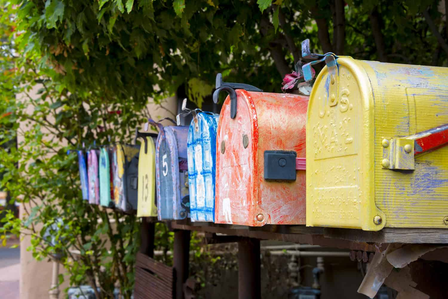 A row of colorful, decorated mailboxes