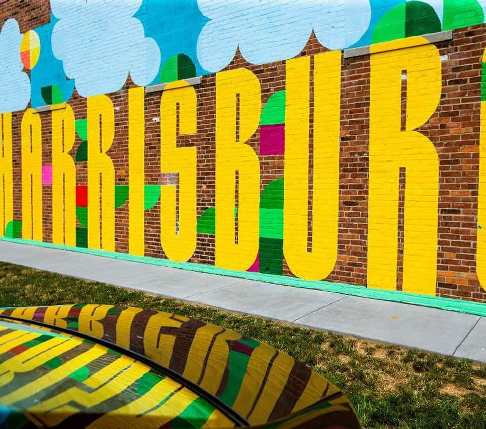 mural on brick wall says Harrisburg in large letters