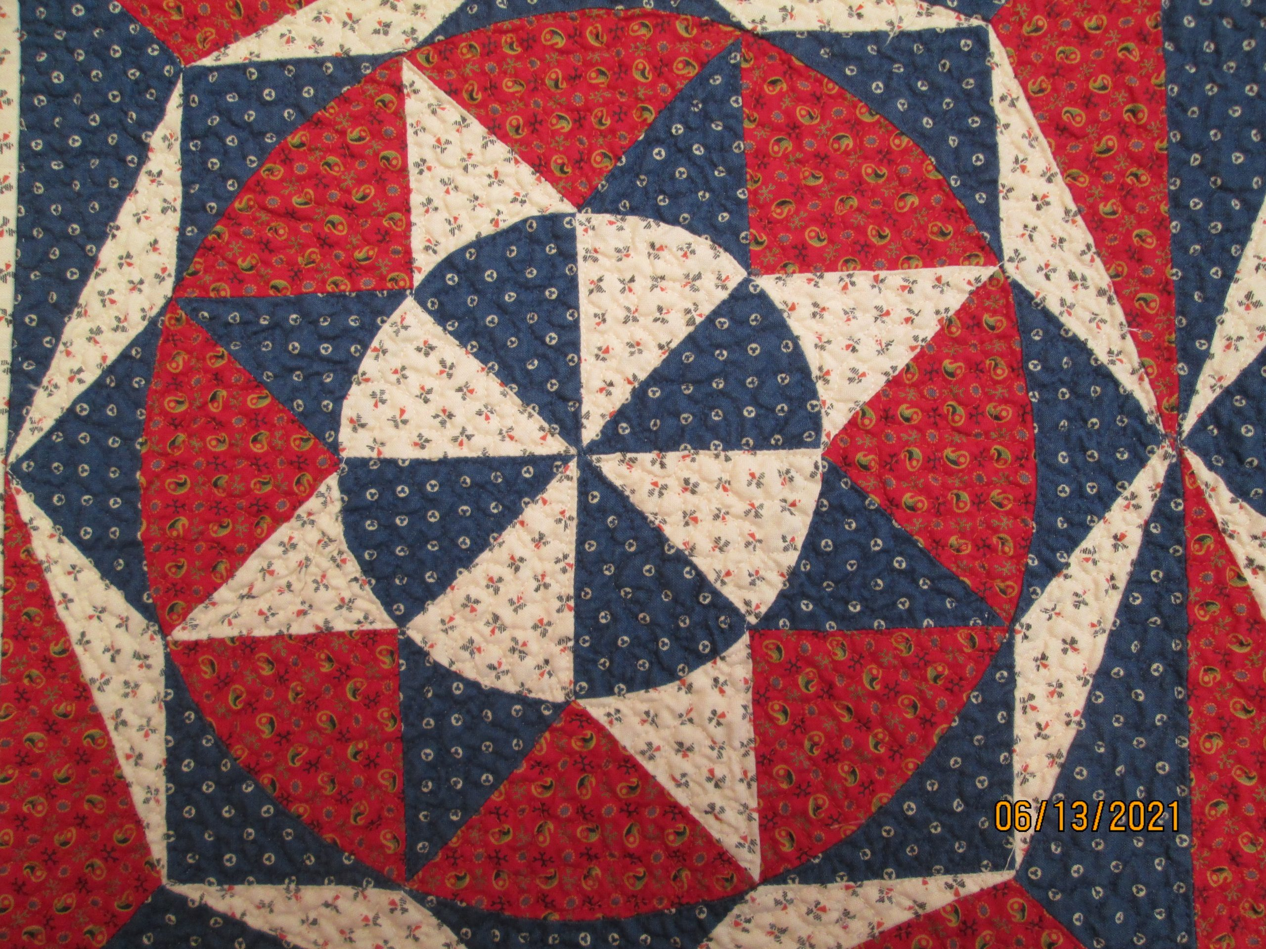 A star quilt pattern in red, white, and blue.