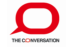 """a red speech bubble with """"The Conversation"""" below"""